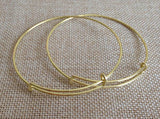 gold color Expandable Bangles