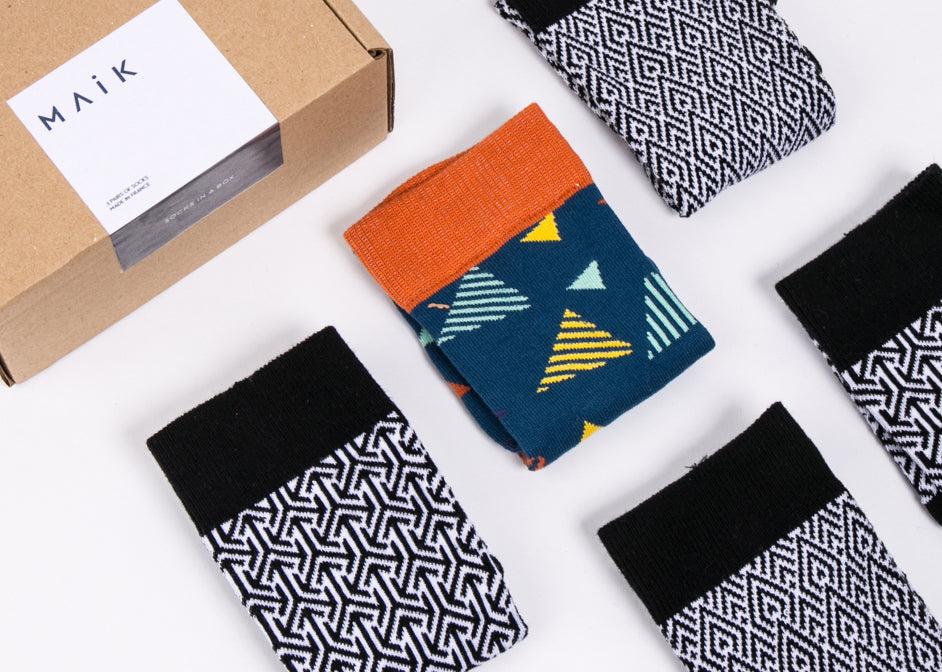 Ethical sock box from MAiK filled with colourful cotton socks.