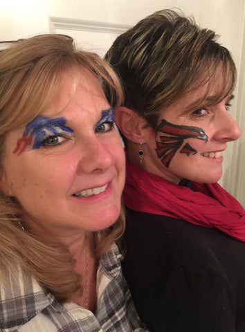 Falcons Logo and Patriots Logo painted faces.