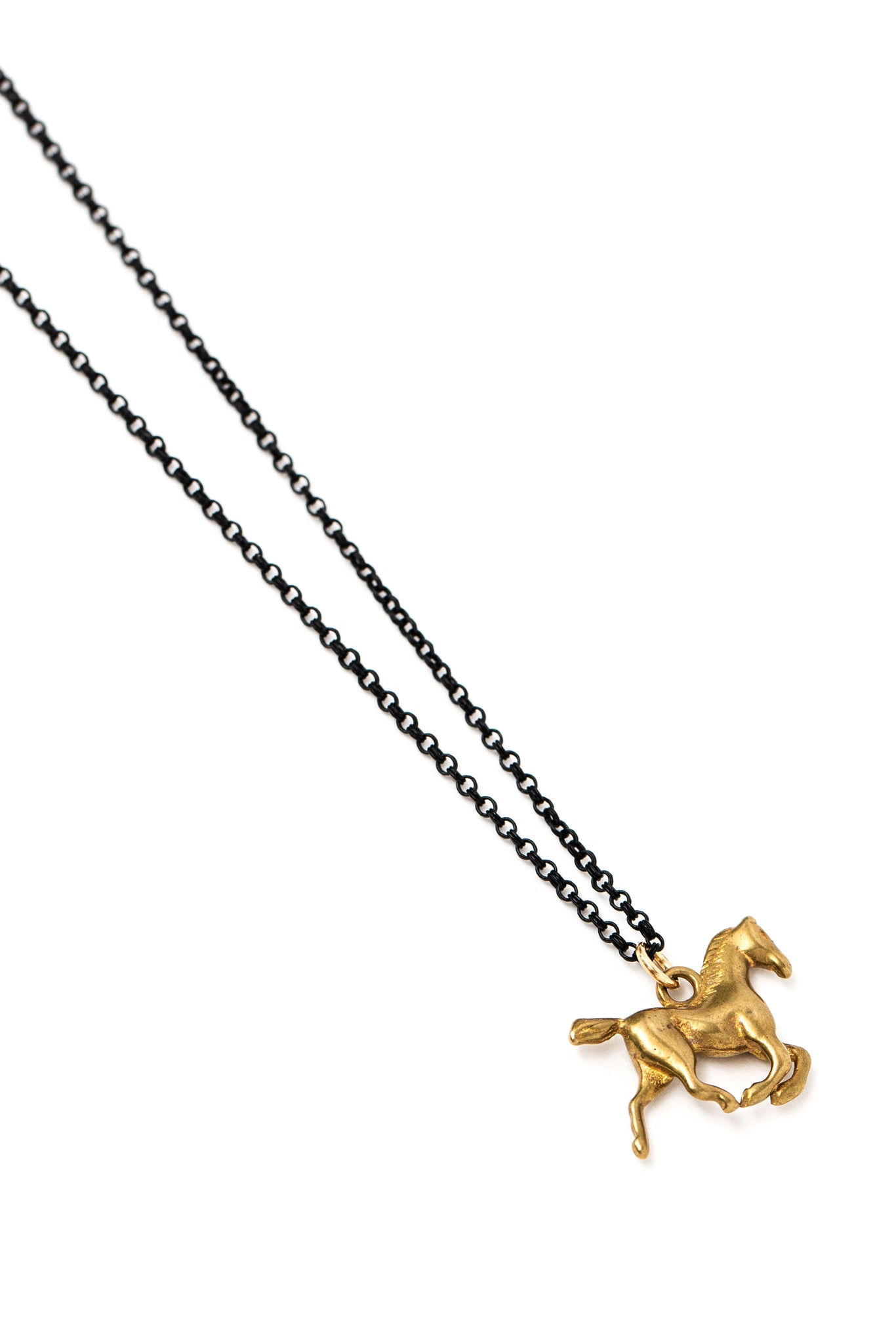 Brass pony charm necklace on double black rolo chain (closeup)