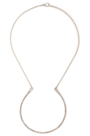 "Hand forged sterling silver curved ""U"" necklace on a silver chain"