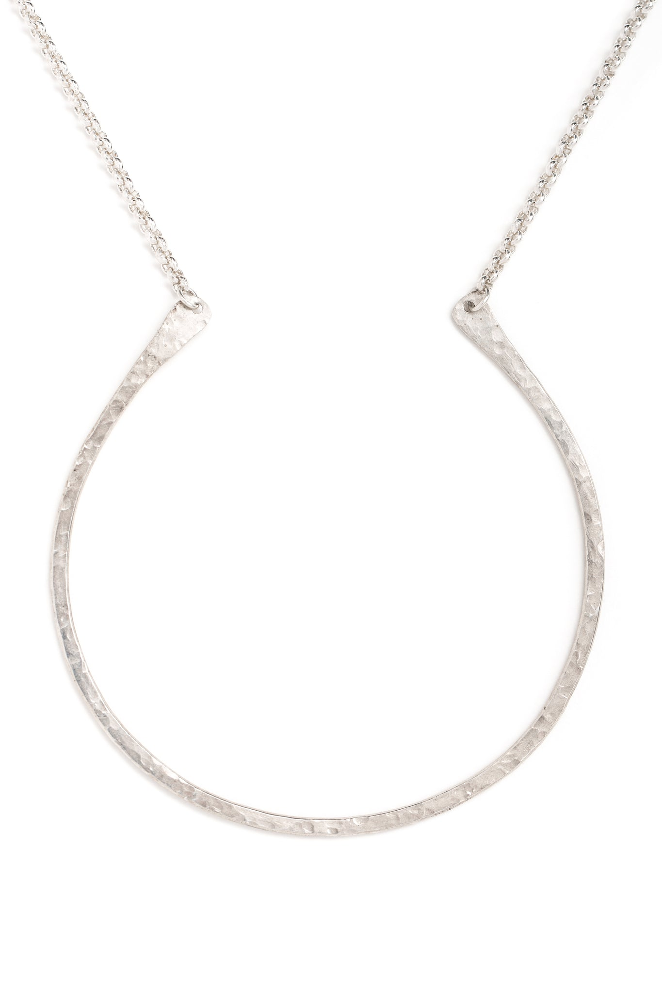 "Hand forged sterling silver curved ""U"" necklace on a silver chain (closeup)"