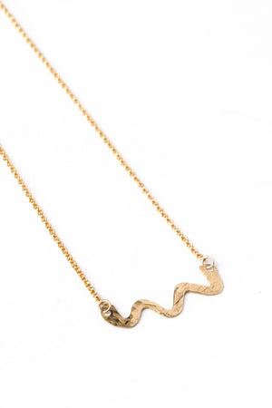 Hand Forged Brass Swiggle Necklace on a Gold Chain (closeup)