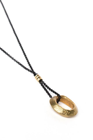 Golden Ethiopian Ring Necklace on Black Chain
