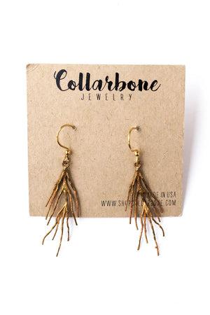 Brass Twig Charm Earrings on a Brown Card