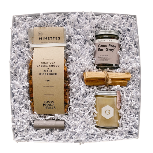 Start the morning right with our RISE + SHINE box which includes gourmet granola, superfood tea blend, a bundle of palo santo, a jar of whipped honey, and a natural lip balm - all packaged in a while gift box with white crinkle paper.