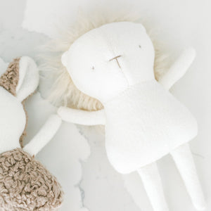 Handmade lion stuffy made with natural fabrics in a minimalist style and hand-stitched facial features. Made in Canada.