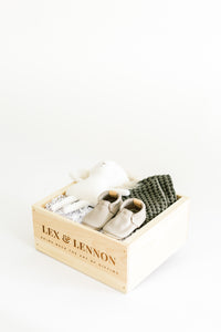 Alternate view of LEO gift box featuring lion stuffy, leather baby shoes, and a pair of olive waffle washcloths.