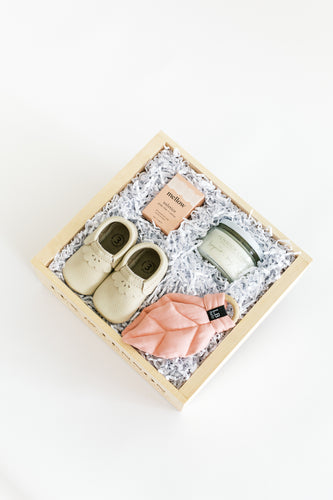 Top view photo of ROSE gift box from a top view, focusing in our leather baby shoes in a cream with scalloped edge.