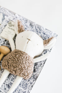 Close up of stuffed sheep toy in Bebé gift box.