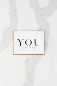 Photo of white greeting card with YOU GOT THIS is letterpress.