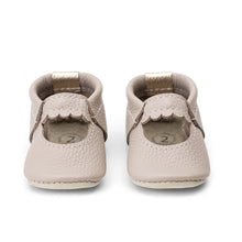 Load image into Gallery viewer, Photo of a pair of baby shoes in a muted light brown with a slight mauve undertone leather in a mini-jane style.