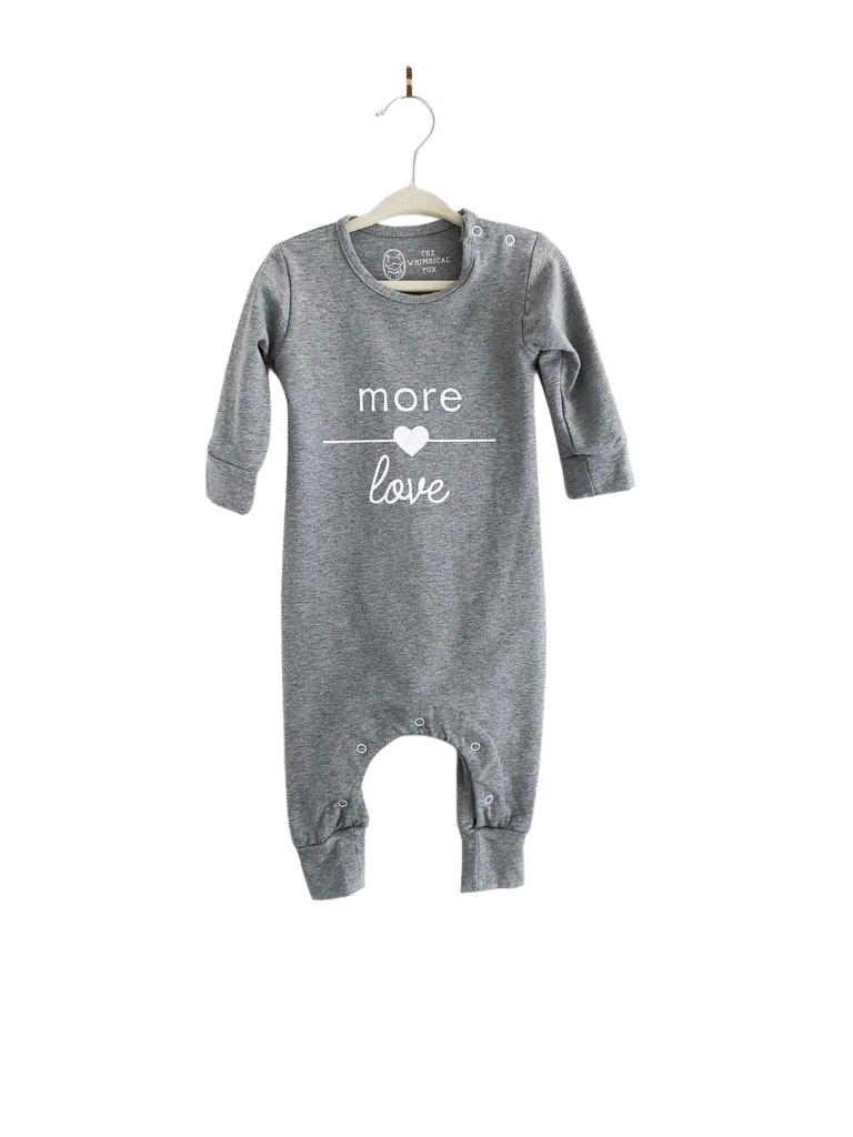 Long-sleeved cotton baby romper with button snaps at shoulder and bottom for easy clothing changes. Designed and printed in Toronto.