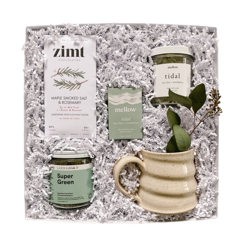 Our RITUAL gift box is packaged in a white gift box with crinkle paper and includes an organic/vegan chocolate bar, superfood green tea, soap bar, bath salts, and a handmade mug. Shop at Lex & Lennon Gifts.
