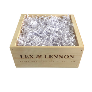 Wooden crate-style box branded with Lex & Lennon and filled with white crinkle paper from Lex & Lennon Gifts.