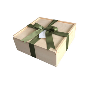 Wooden gift box with slider-top lid, hand-wrapped in ribbon and affixed branded tag from Lex & Lennon Gifts.