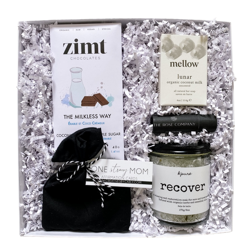 MAMA gift box from Lex & Lennon Gifts, features a set of affirmation cards, organic chocolate bar, bath salts, natural lip balm, and soap bar - packaged in a white git box and crinkle paper.