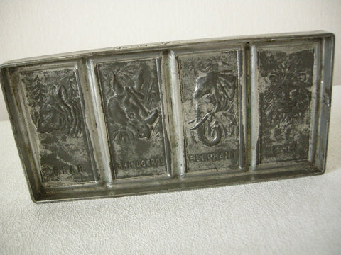 Early 20th century German tinned metal chocolate mold for 4 animals including a bear and lion