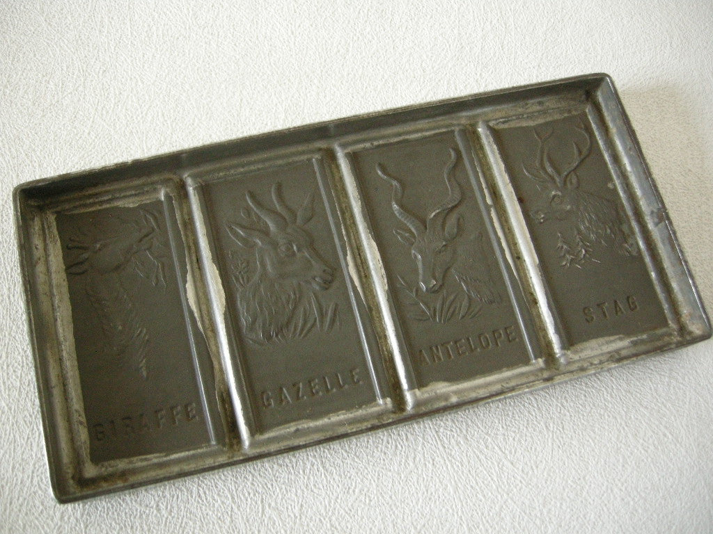 Early 20th century German tinned metal chocolate mold for 4 animals including a stag & giraffe 1 in stock Kitchenalia Collecting The World Select product, EARLY 20TH CENTURY GOLDEN PYRAMID GRAMAPHONE NEEDLE TIN AND BOX Golden pyramid tin 1 thumb	EARLY 20TH