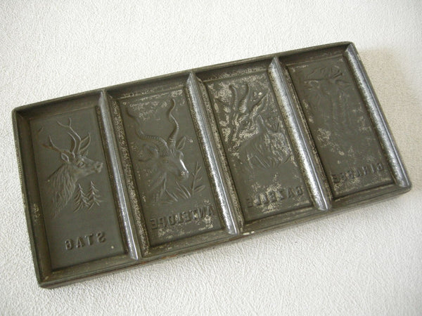 Early 20th century German tinned metal chocolate mold for 4 animals including a stag & giraffe