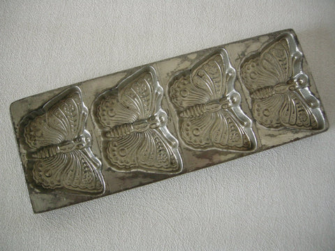 Excellent arly 20th century tinned metal chocolate mold for 4 butterflies