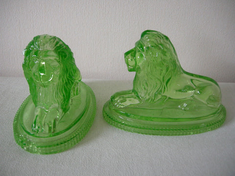 Pair of John Derbyshire uranium pressed glass lions registered in 1874