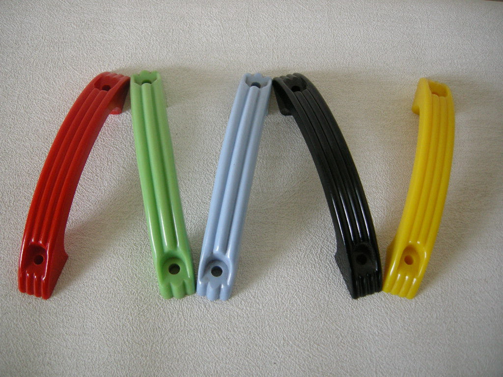 Unused large plastic vintage pull handles from the 1950s in blue, yellow, red, green & black