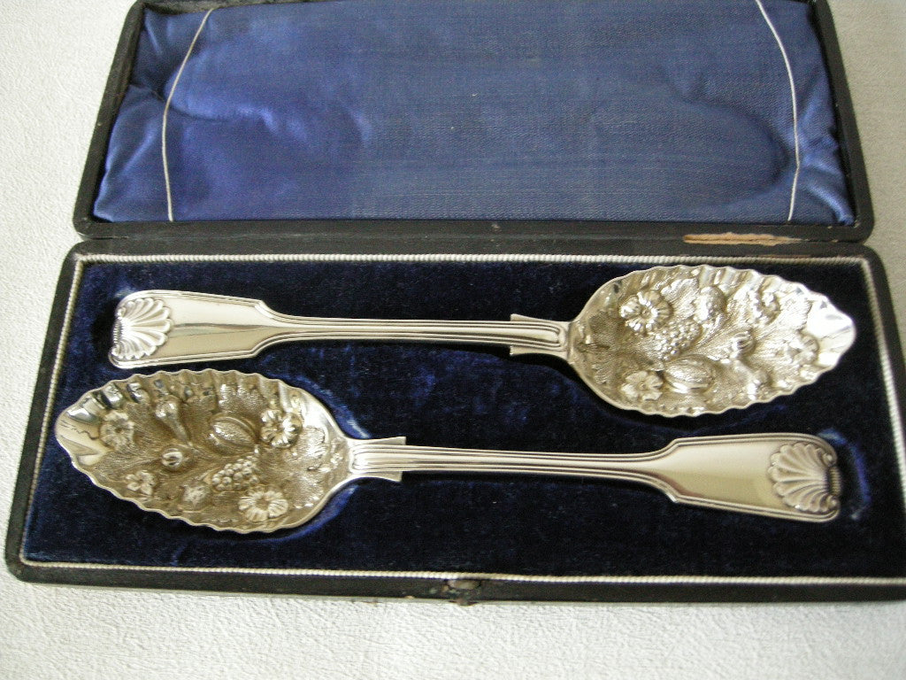 Superb boxed pair of large Victorian embossed dessert spoons in white metal