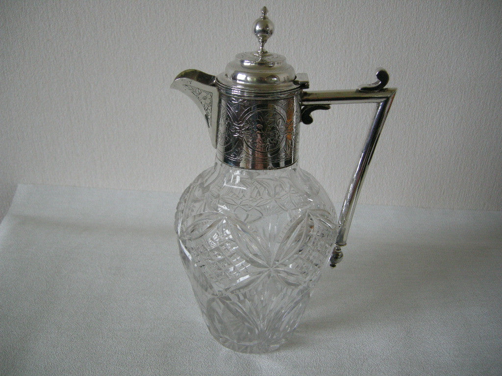 Late Victorian art nouveau silver topped claret jug in the Christopher Dresser style