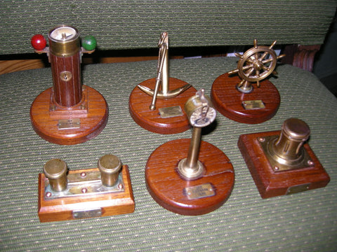 Group of 6 miniature teak and brass fittings from MV PINEWOOD dated 1978