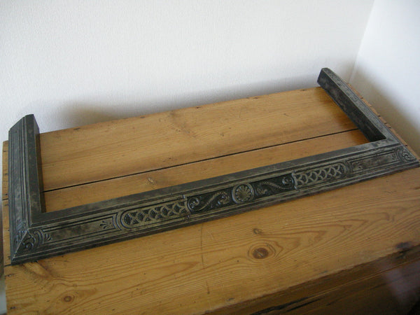 Small early 20th century cast iron fender decorated with dolphins and shells
