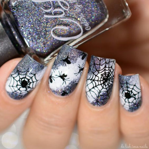 spider web nails halloween manicure