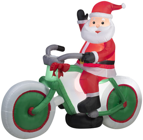 Santa Claus riding a bicycle airblown