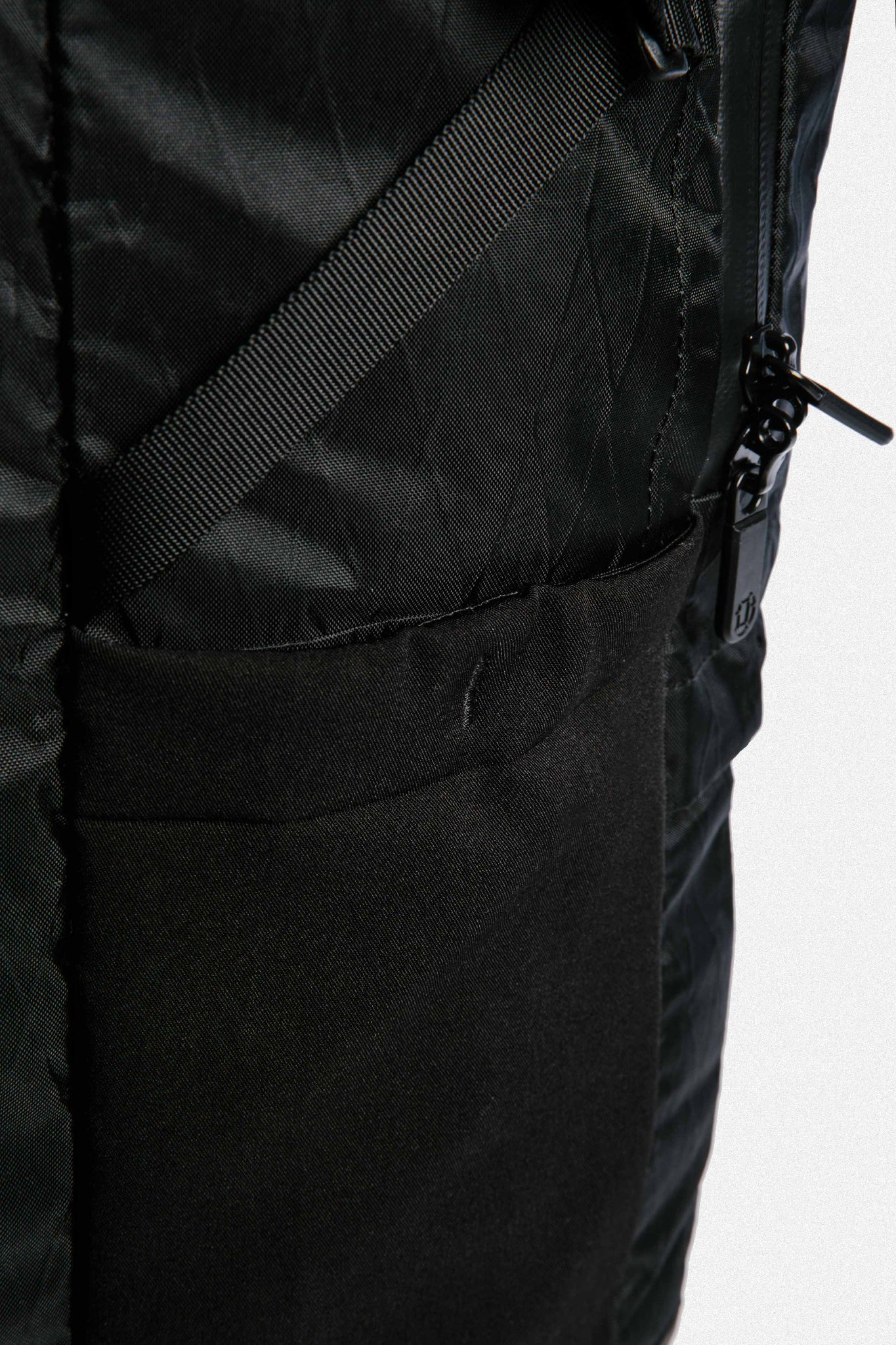 Locking zippers on a theft-proof backpack