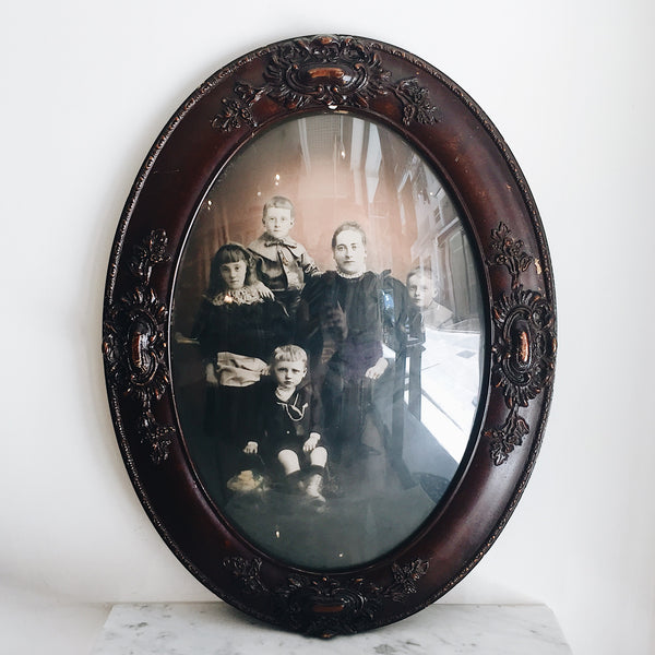 Antique Victorian Family Portrait with Carved Oval Frame