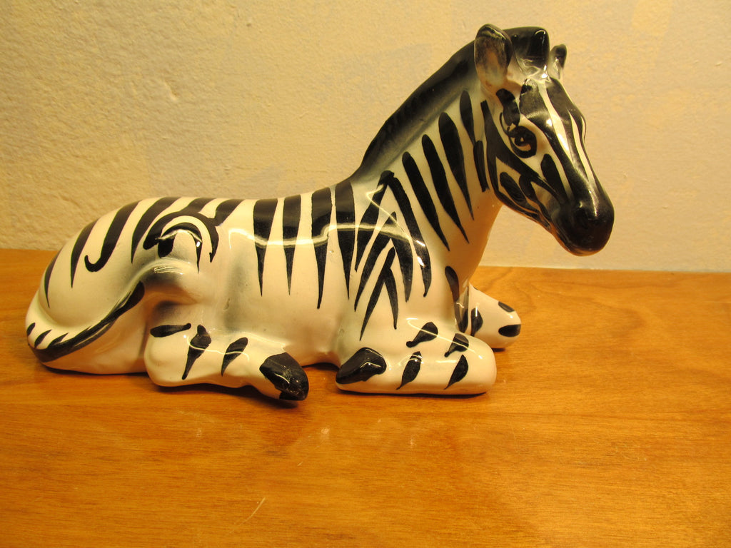 large ceramic laying down zebra