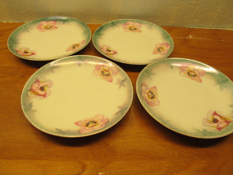 A VINTAGE SET OF FOUR MADE IN 1940 P.V. VASSRA PLATES - Andres James Vintage Boutique