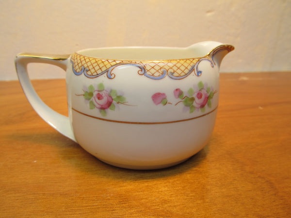 VINTAGE NIPPON SUGAR AND CREAMER WITH LACE TATTING PATTERN