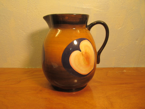 j.p. products made in China beverage pitcher with plum design.