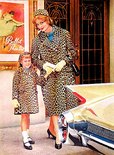 Mother - Daughter matching leopard coats in a Cadillac Ad