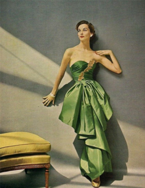 Vintage fabric ad featuring a William Rose Enka Rayon couture evening dress