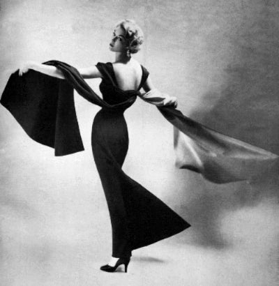 1953-Jean Patchett twirling in a Bernard Newman dress Richard Avedon