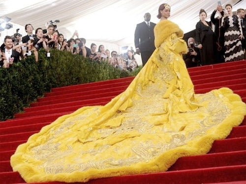 Rihanna in embroidered yellow Guo Pei cape MET costume institute Gala 2015