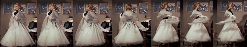 Grace Kelly twirling in Edith Head dress in Rear Window 1954