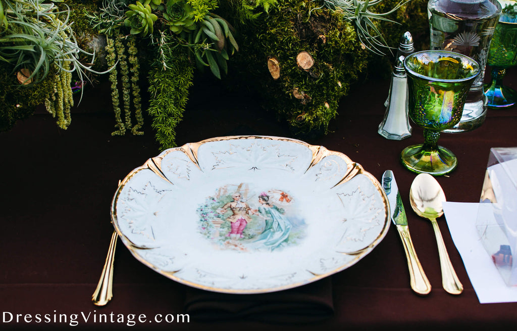 Vintage china and gold flatwear wedding table
