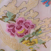 Detail of fine embroidery work on a vintage 1920's lace dress