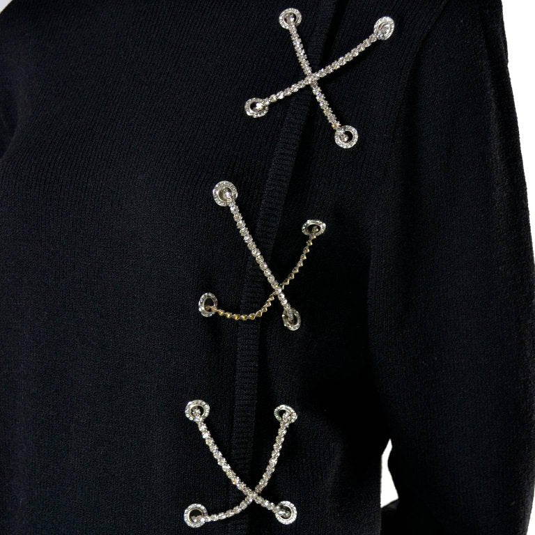Rhinestone X's on a 1980's vintage black knit wool sweater