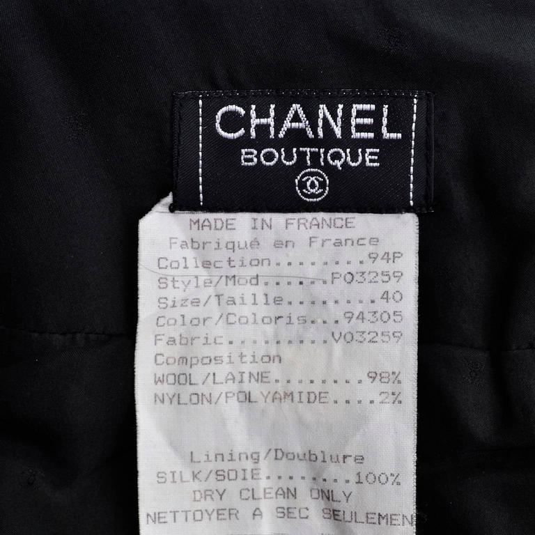Chanel Boutique 1990's black boucle wool suit with black plastic trim