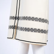 1970's skirt and vest in white crepe wool with black trim and matching belt
