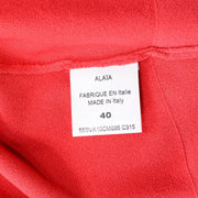 Alaia label on coral sweater size 40